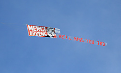 A banner honouring outgoing Arsenal manager Arsene Wenger being pulled by a plane above the ground during the Premier League match at the John Smith's Stadium, Huddersfield.