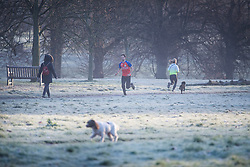 © Licensed to London News Pictures. 22/01/2021. London, UK. Members of the public exercise through a frost covered landscape in Hyde Park, central London on a cold winter morning. Parts of the UK are currently experiencing heavy flooding caused by heavy rainfall during storm Christoph.  Photo credit: Ben Cawthra/LNP