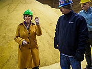 12 APRIL 2019 - NEVADA, IOWA: US Senator AMY KLOBUCHAR, (D-MN) and CHRIS CLEVELAND, Production Manager of Lincolnway Energy, look at corn that will be turned into ethanol during a tour of the Lincolnway Energy ethanol plant in Nevada, IA. Sen. Klobuchar is touring Iowa this weekend to support her bid for the Democratic nomination of for the US Presidency. Iowa traditionally hosts the the first election event of the presidential election cycle. The Iowa Caucuses will be on Feb. 3, 2020.          PHOTO BY JACK KURTZ