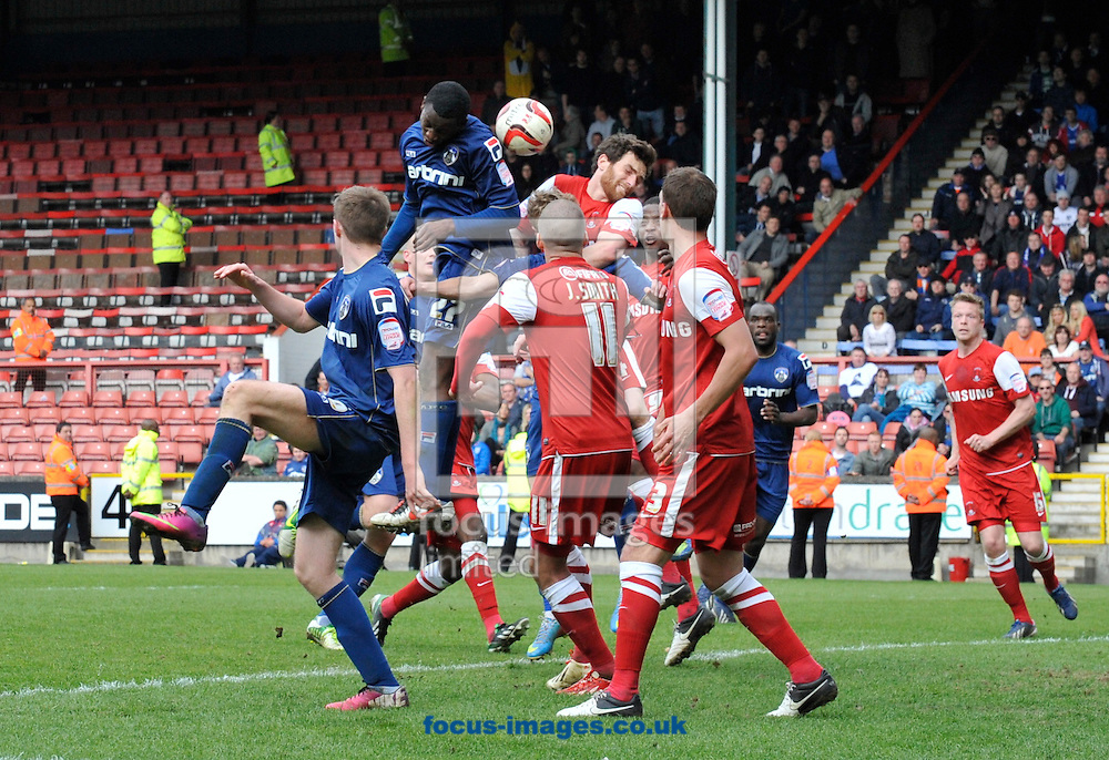 Picture by Alan Stanford/Focus Images Ltd +44 7915 056117.27/04/2013.Glenn Belezika of Oldham Athletic heads the ball towards goal during the npower League 1 match at the Matchroom Stadium, London.. .