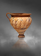Minoan decorated cup with foliage, Archanes Palace  1600-1450 BC; Heraklion Archaeological  Museum, grey background. .<br /> <br /> If you prefer to buy from our ALAMY PHOTO LIBRARY  Collection visit : https://www.alamy.com/portfolio/paul-williams-funkystock/minoan-art-artefacts.html . Type -   Heraklion   - into the LOWER SEARCH WITHIN GALLERY box. Refine search by adding background colour, place, museum etc<br /> <br /> Visit our MINOAN ART PHOTO COLLECTIONS for more photos to download  as wall art prints https://funkystock.photoshelter.com/gallery-collection/Ancient-Minoans-Art-Artefacts-Antiquities-Historic-Places-Pictures-Images-of/C0000ricT2SU_M9w