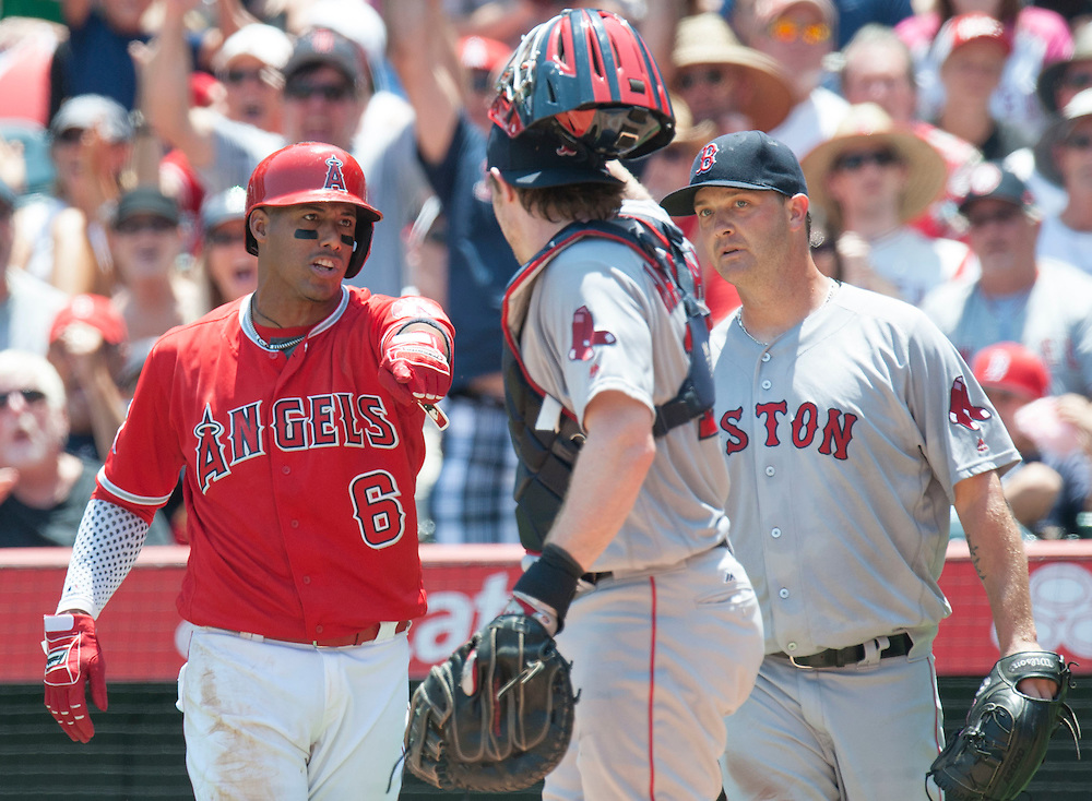 The Angels' Yunel Escobar argues after failing to step on home plate as Red Sox starter Steven Wright and catcher Ryan Hanigan stand by in the first inning at Angel Stadium on Sunday.<br /> <br /> ///ADDITIONAL INFO:   <br /> <br /> angels.0730.kjs  ---  Photo by KEVIN SULLIVAN / Orange County Register  -- 7/31/16<br /> <br /> The Los Angeles Angels take on the Boston Red Sox at Angel Stadium.