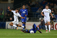 Kemar Roofe of Leeds Utd (l) is tackled by Sol Bamba of Cardiff City. EFL Skybet championship match, Cardiff city v Leeds Utd at the Cardiff city stadium in Cardiff, South Wales on Tuesday 26th September 2017.<br /> pic by Andrew Orchard, Andrew Orchard sports photography.