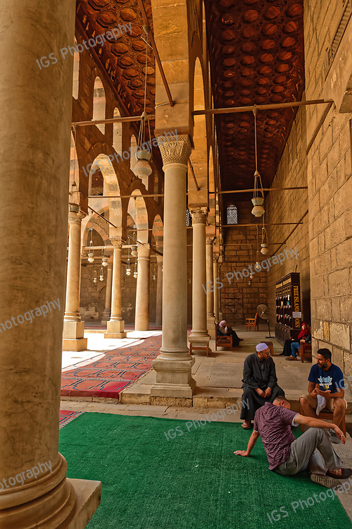 Moslem Worshippers relaxing in the Al Nasir Muhammad mosque after daily noon  prayers