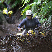People riding through the mud on a quad bike course near Taupo with Taupo Quad Bikes. Taupo, North Island, New Zealand. 7th January 2011. Photo Tim Clayton.