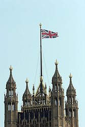 21 April 2010. London, England..The Union Jack flutters in the breeze atop the Houses of Parliament..Photo; Charlie Varley.