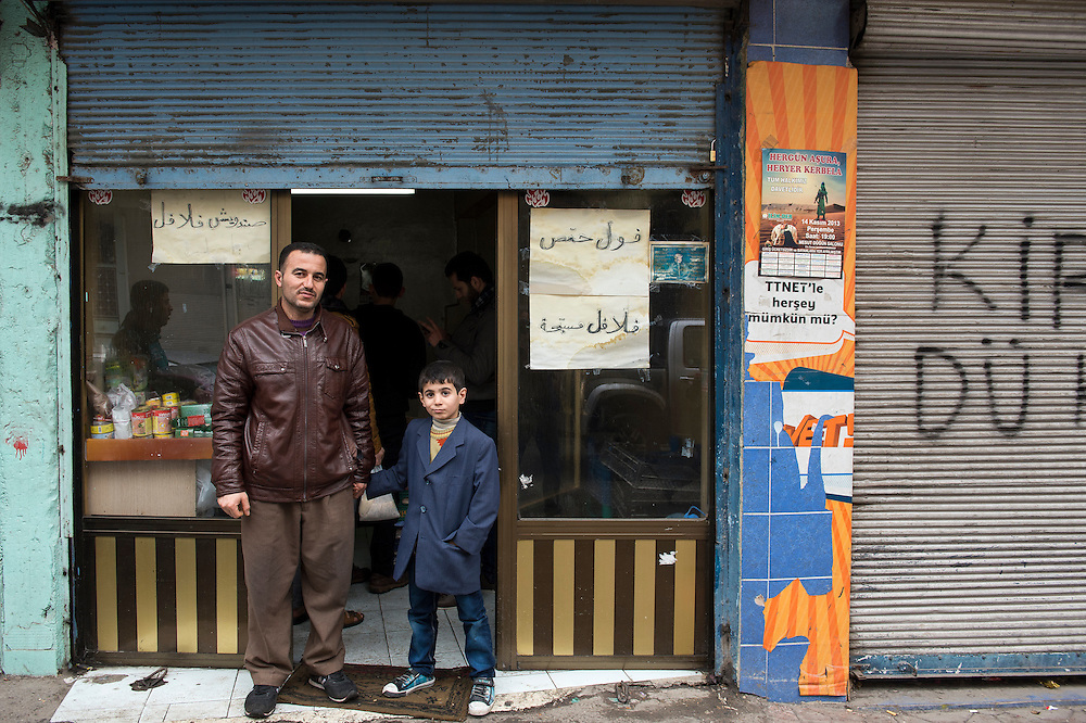 Ahmad Amidou, syrian refugee, was a teacher in Aleppo but works here in Gaziantep, Turkey, in a factory since one year. His son, Mohammed 6 years, was afraid in Aleppo. Every month Ahmad returns to Aleppo.