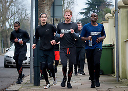 Prince Harry jogs with volunteers and young homeless people from The Running Charity in Willesden Green, London.