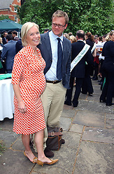 TV presenter MARIELLA FROSTRUP and her husband JASON McCUE at the annual House of Lords v House of Commons tug of war match in aid of  of  Macmillan Cancer Relief on 22nd June 2004.  A drinks reception was held in College Gardens followd by the tug of war on Victoria Tower Gardens, London.