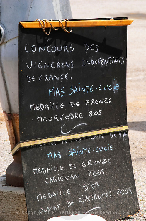 Sign advertising medal at wine competition, Mas Sainte Lucie. Domaine de Nidoleres. Roussillon. France. Europe.