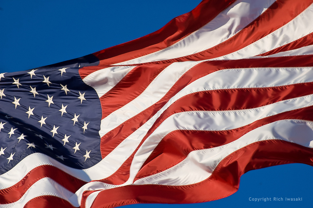 Closeup view of the American flag flying at the World War II Memorial, Washington, DC