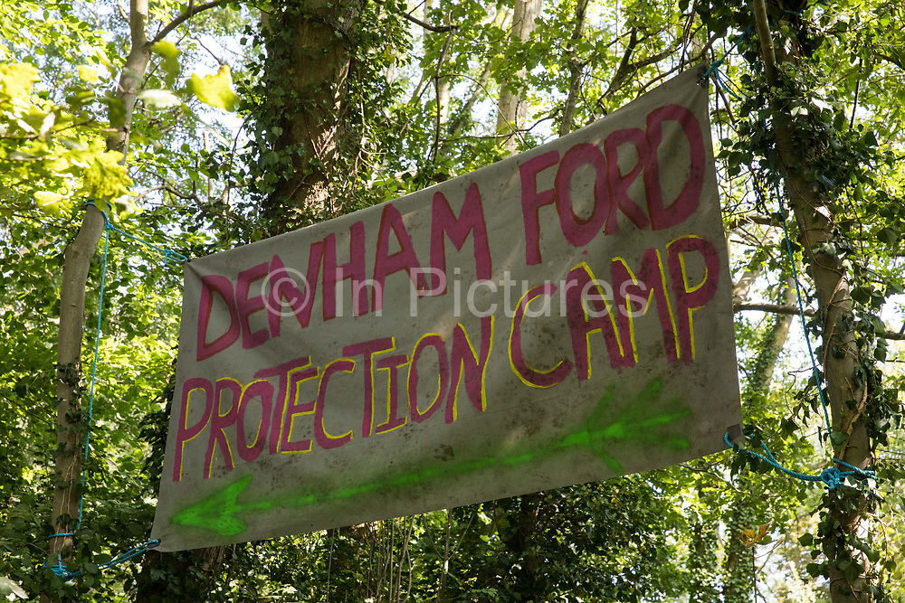 A banner hung from trees close to Denham Ford Protection Camp by anti-HS2 activists is pictured on 21 September 2020 in Denham, United Kingdom. Activists opposed to the HS2 high-speed rail link on environmental and cost grounds continue to try to prevent or delay works from a series of protection camps based along the route of the line between London and Birmingham.