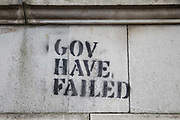 Graffiti criticising the British government is pictured close to the Houses of Parliament on 30 October 2020 in London, United Kingdom. There has been widespread criticism of the Government's handling of the coronavirus pandemic.
