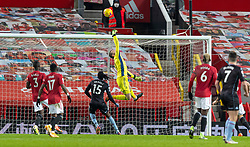 MANCHESTER, ENGLAND - Friday, January 1, 2020: Manchester United's goalkeeper David de Gea makes a save during the New Year's Day FA Premier League match between Manchester United FC and Aston Villa FC at Old Trafford. The game was played behind closed doors due to the UK government putting Greater Manchester in Tier 4: Stay at Home during the Coronavirus COVID-19 Pandemic. (Pic by David Rawcliffe/Propaganda)