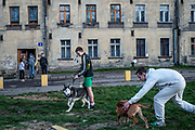 A group of friends gather together outside their apartment complex in a region of Wałbrzych, Poland. Work is hard to come by and some young men turn to mining coal locally for jobs.