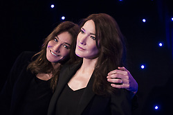 French-Italian model and singer Carla Bruni-Sarkozy poses next to a wax sculpture depecting herself during its inauguration on December 17, 2018 at the Musee Grevin wax museum in Paris. Photo by Eliot Blondet/ABACAPRESS.COM