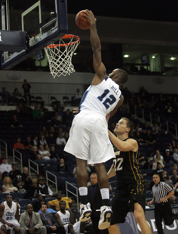 Jan 7, 2012; Norfolk, VA, USA; Old Dominion Monarchs guard Donte Hill (12) dunks the ball against the Towson Tigers at the Ted Constant Convocation Center. Mandatory Credit: Peter Casey-US PRESSWIRE