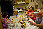 At home after work, meat grinder Kelvin Lester enjoys a dinner of grilled hamburger patties with his family in Grand Meadow, Minnesota. (Kelvin Lester is Featured in the book What I Eat: Around the World in 80 Diets.)