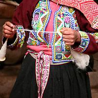 Americas, South America, Peru, Cusco.  Girl spinning wool at Awana Kancha.