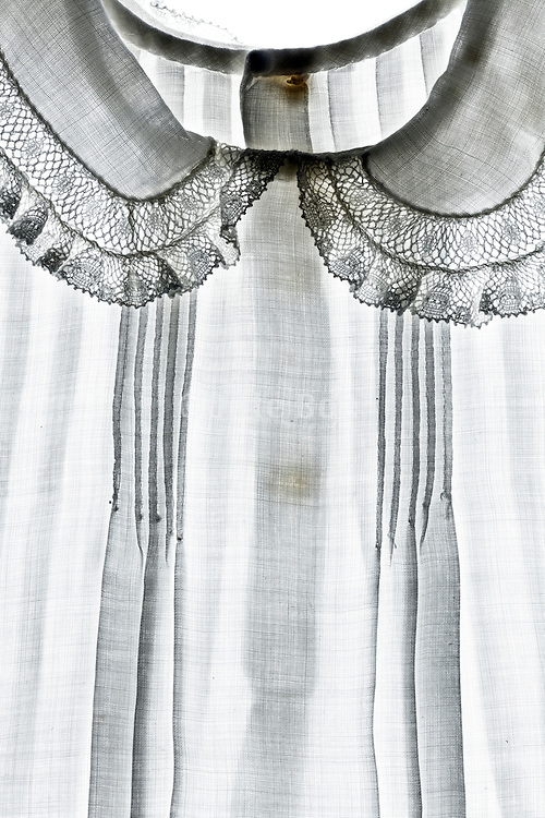 detail of an white dress with collar lace embroidery