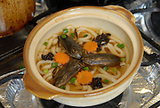"""Taiwanese water bugs with Japanese udon noodles. Tokyo resident Shoichi Uchiyama is the author of """"Fun Insect Cooking"""". His blog on the topic gets 400 hits a day. He believes insects could one day be the solution to food shortages, and that rearing bugs at home could dispel food safety worries."""