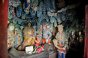 Some statues of Buddha are seen at the Hanging Temple, also called Hanging Monastery or Xuankong Temple (simplified Chinese: 悬空寺 ; pinyin: Xuánkōng Sì), in Datong, China, July 24, 2014.<br /> <br /> Confucianism, Taoism and Buddhism are the three major religions in China. Temples and statues witness their ancient roots all over the Chinese country.<br /> <br /> © Giorgio Perottino