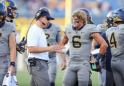 Sep 11, 2021; Morgantown, West Virginia, USA; West Virginia Mountaineers head coach Neal Brown talks with West Virginia Mountaineers quarterback Garrett Greene (6) during the second quarter against the Long Island Sharks at Mountaineer Field at Milan Puskar Stadium. Mandatory Credit: Ben Queen-USA TODAY Sports