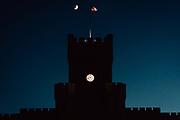 A waxing crescent moon sets over Padgett-Thomas Barracks at The Citadel on Thursday, August 12, 2021.<br /> <br /> Credit: Cameron Pollack / The Citadel