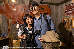 Photographer Nozomi Fujimura at the 27th Annual Mooneyes Yokohama Hot Rod Custom Show 2018. Yokohama, Japan. Sunday, December 2, 2018. Photography ©2018 Michael Lichter.