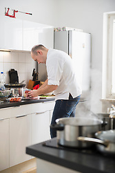 Chef cooking food in the kitchen