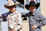 November 2, 2008 -- PHOENIX, AZ: Spectators behind the bucking chutes at the Arizona High School Rodeo at the Arizona State Fair in Phoenix. Teams from across the state participate. The Arizona High School Rodeo Association sponsors a full season of high school rodeo that culminate in a championship rodeo in June.  Photo by Jack Kurtz