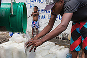 2016/05/25 - Caracas, Venezuela: A man fills containers with water of a communal well in the Petare neighbourhood of Caracas. The water reserves of the neighbourhood are completely empty, so the population has to use the water of this well to stock for water provisions. Caracas as the rest of the country is getting shortages on food, water and electricity. (Eduardo Leal)