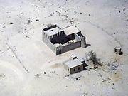Traditional adobe mud house and compound in desert, Saudi Arabia 1979