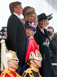 © Licensed to London News Pictures. 23/10/2018. London, UK. King Willem-Alexander, Queen Elizabeth II, Queen Maxima, Prince Charles and Camilla, Duchess of Cornwall, share a joke during a ceremony on Horse Guards Parade in London for the arrival of King Willem-Alexander and Queen Maxima of the Netherlands as part of a state visit to the UK. Photo credit: Ben Cawthra/LNP