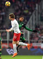 WROCLAW, March 24, 2018  Lukasz Piszczek (L) of Poland vies with Joel Obi of Nigeria during an international friendly game between Poland and Nigeria in Wroclaw, Poland, on March 23, 2018. Nigeria won 1-0. (Credit Image: © Jaap Arriens/Xinhua via ZUMA Wire)