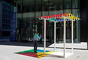 Art in the City artwork entitled 4 Colours at 3 Meter High by Daniel Buren leaves multi-coloured patterns from strong sunlight  on the pavement at One Creechurch Place, on 17th Juy 2017, in the City of London, England.