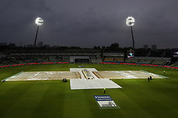 Rain covers on the pitch under floodlights during day two of the First Investec Test match at Edgbaston, Birmingham.