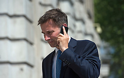 © London News Pictures. 22/05/2011. London, UK. Secretary of State for Culture, Olympics, Media and Sport Jeremy Hunt MP arriving at the cabinet office on Whitehall on May 22, 2012 for a cabinet meeting. It was announced yesterday (Monday) that JEREMY HUNT will face a Parliamentary inquiry into claims he failed to register corporate hospitality. Photo credit: Ben Cawthra/LNP