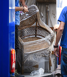 """© Licensed to London News Pictures. 16/07/2016. London, UK. A wicker chair marked for """"BED 1 TOP FLOOR""""  being placed in a van for David Cameron. Removal men begin to take items from numbers 10 and 11 at Downing Street at the end of the week that saw Prime Minister David Cameron leave and Theresa May arrive. Photo credit: Ben Cawthra/LNP"""