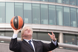 © Licensed to London News Pictures. 08/04/2013. London, England. Boris Johnson playing hoops with Pops Mensah-Bonsu. London Mayor Boris Johnson promotes the 2013 Turkish Airlines Euroleague Final Four to be played at The O2 from 10th - 12th May 2013, and to reveal the programme of free activities that will take place in conjunction with the event to get Londoners involved with basketball. Photo credit: Bettina Strenske/LNP