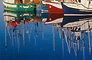Reflection of Fishing boats<br /> Goose Cove<br /> Newfoundland <br /> Canada