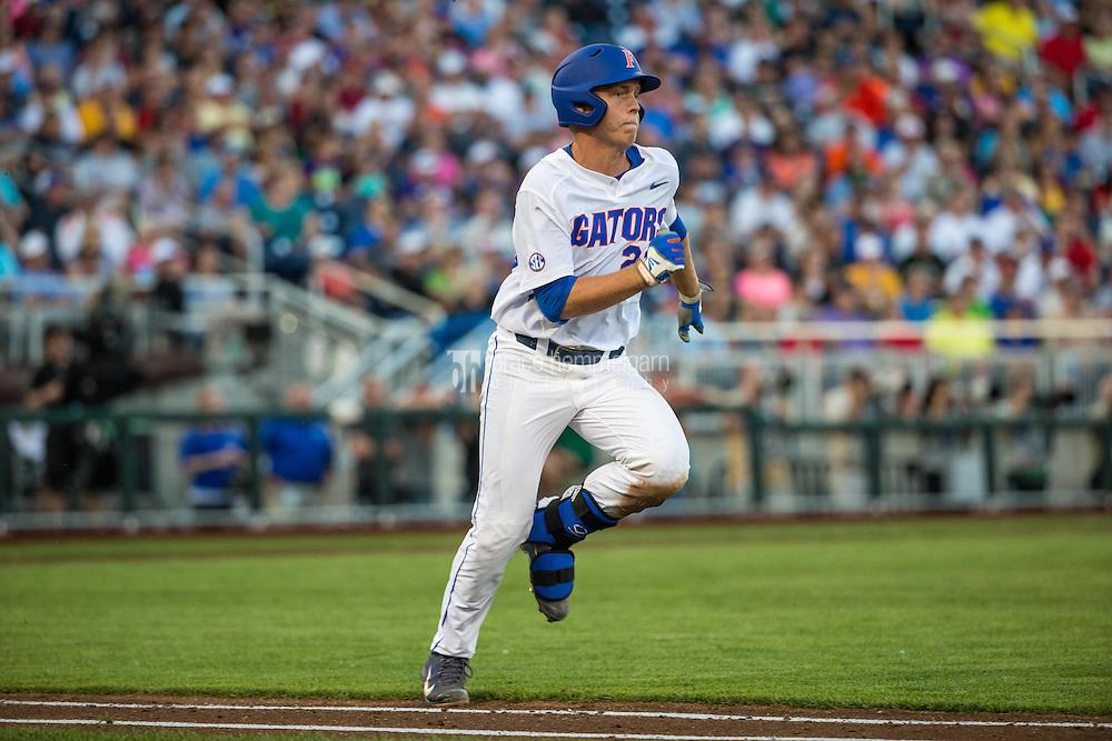 JJ Schwarz (22) of the Florida Gators runs during a game between the Miami Hurricanes and Florida Gators at TD Ameritrade Park on June 13, 2015 in Omaha, Nebraska. (Brace Hemmelgarn)
