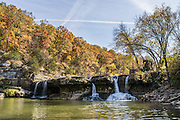 Upper Falls, in Cataract Falls State Recreation Area –  Indiana's largest-volume waterfall. Mill Creek plunges 20 feet in the set of Upper Falls, and a half a mile downstream the Lower Falls drops 18 feet, for a total drop of 86 feet including intermediate cascades. Autumn foliage colors were brilliant but water volume was low for this photo in mid October 2015. The park's limestone outcroppings formed millions of years ago when the region was covered by a large shallow ocean. Cataract Falls State Recreation Area is an hour southwest of Indianapolis, near Cloverdale, Indiana, USA.