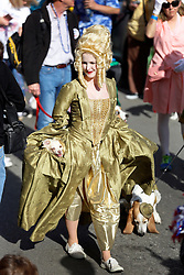 31 January 2016. New Orleans, Louisiana.<br /> Mardi Gras Dog Parade. Jenna McMullen with dog Caddo (in dress) and Abigail. The Mystic Krewe of Barkus winds its way around the French Quarter with dogs and their owners dressed up for this year's theme, 'From the Doghouse to the Whitehouse.' <br /> Photo©; Charlie Varley/varleypix.com