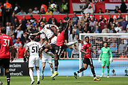 Kyle Bartley of Swansea city challenges Romelu Lukaku of Manchester Utd to a header. Premier league match, Swansea city v Manchester Utd at the Liberty Stadium in Swansea, South Wales on Saturday 19th August 2017.<br /> pic by  Andrew Orchard, Andrew Orchard sports photography.