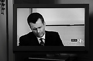 Evening news broadcast from Swiss state broadcaster TSR of Philipp Hildebrand, Chairman of the Swiss National Bank, during a press conference in Bern on 9th January in which he resigned, shortly before the bank announced an unexpectedly high CHF 13 billion profit.