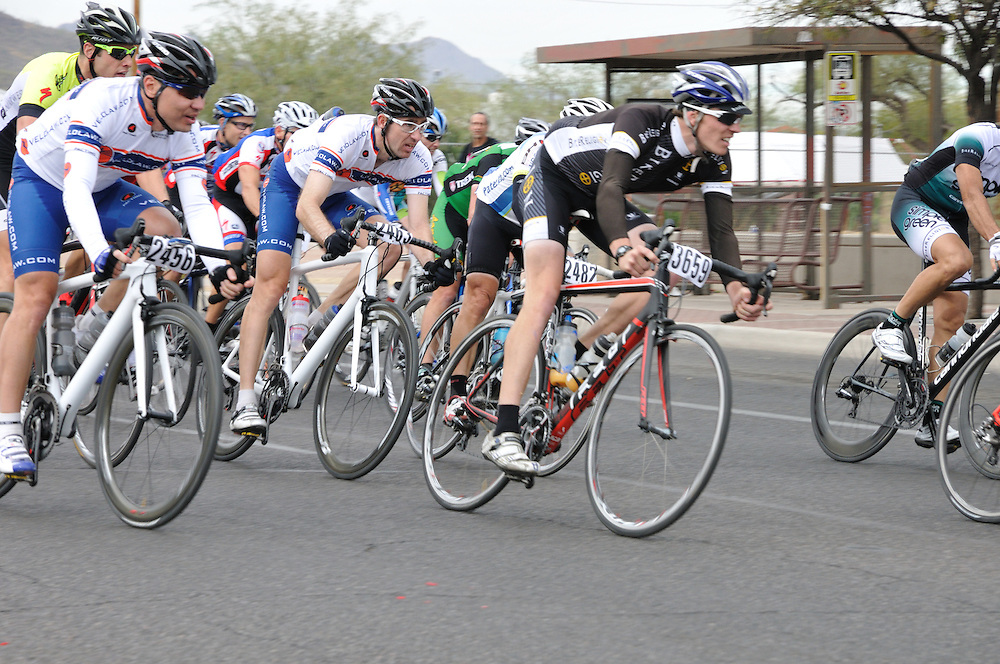 El Tour de Tucson 2012 finishers rounding the race's final corner at 22nd Street and 6th Avenue. Bike-tography by Martha Retallick.