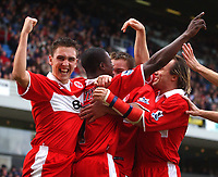 Photo: Back Page Images. 16/10/2004.<br /> Barclays Premiership. Blackburn Rovers v Middlesbrough. Ewood Park.<br /> Stuart Downing facing the camera is one of many celebrating Boro players after George BOateng put the Boro 2-0 up