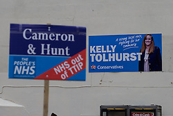 "© Licensed to London News Pictures . 17/11/2014 . Kent , UK . Mock estate agent board calling for "" NHS out of TTIP "" and referencing Prime Minister David Cameron and Health Secretery Jeremy Hunt , outside the Conservative campaign shop on High Street Rochester . Photo credit : Joel Goodman/LNP"