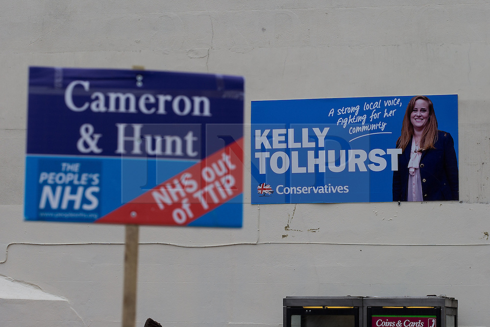 """© Licensed to London News Pictures . 17/11/2014 . Kent , UK . Mock estate agent board calling for """" NHS out of TTIP """" and referencing Prime Minister David Cameron and Health Secretery Jeremy Hunt , outside the Conservative campaign shop on High Street Rochester . Photo credit : Joel Goodman/LNP"""